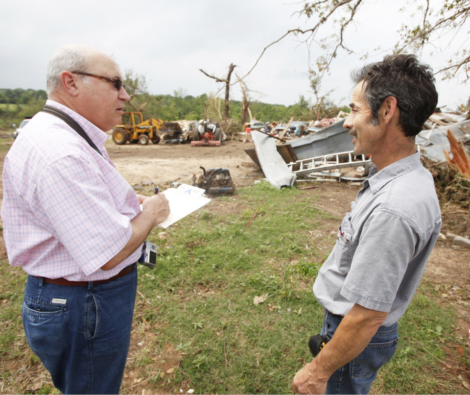 Below, left: Steve Johnson, right, talks Wednesday with insurance adjuster Len Kaufman, of American Modern Insurance Group. PHOTOS BY STEVE GOOCH, THE OKLAHOMAN
