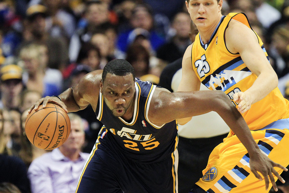Utah Jazz center Al Jefferson (25) drives past Denver Nuggets center Timofey Mozgov (25), of Russia, during the first quarter of an NBA basketball game, Friday, Nov. 9, 2012, in Denver. (AP Photo/Barry Gutierrez)