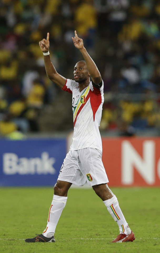 Photo - Mali's captain Seydou Keita celebrates after scoring against South Africa in their African Cup of Nations quarterfinal soccer match, at Moses Mabhida Stadium in Durban, South Africa, Saturday, Feb. 2, 2013. (AP Photo/Rebecca Blackwell)