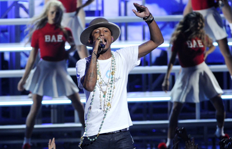 Photo - Pharrell Williams performs at the BET Awards at the Nokia Theatre on Sunday, June 29, 2014, in Los Angeles. (Photo by Chris Pizzello/Invision/AP)