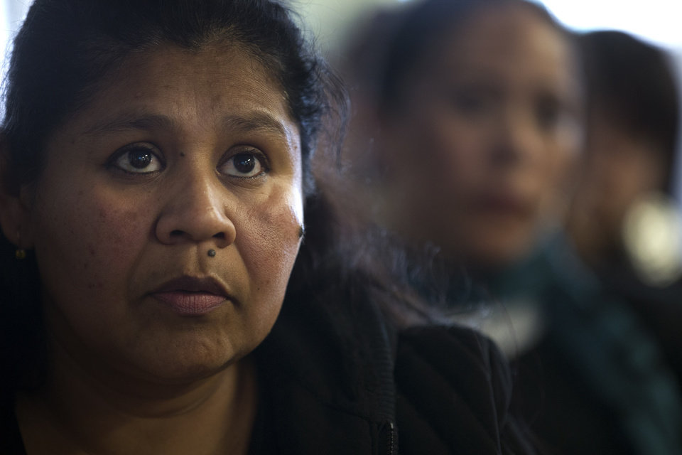 Photo - Adelfina Guzman listens along with immigration advocates to President Barack Obama's speech on immigration reform, Tuesday, Jan. 29, 2013, in San Diego. The President on Tuesday praised bipartisan efforts to overhaul the nation's immigration laws, welcoming
