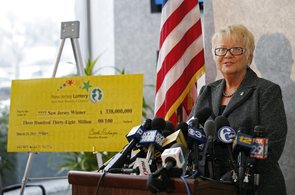 Photo - Carole Hedinger, Executive Director of the New Jersey Lottery, announces that the winning ticket in the $338 million Powerball was sold at Eagle Liquors in Passaic  N.J.. The announcement was made from lottery headquarters in Lawrence, N.J. Monday, March 25, 2013. (AP Photo/Rich Schultz)