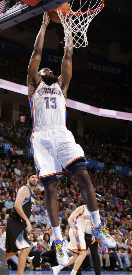 Oklahoma City's James Harden (13) dunks the ball during the NBA basketball game between the Oklahoma City Thunder and the Minnesota Timberwolves at Chesapeake Energy Arena in Oklahoma City, Friday, March 23, 2012. Photo by Bryan Terry, The Oklahoman