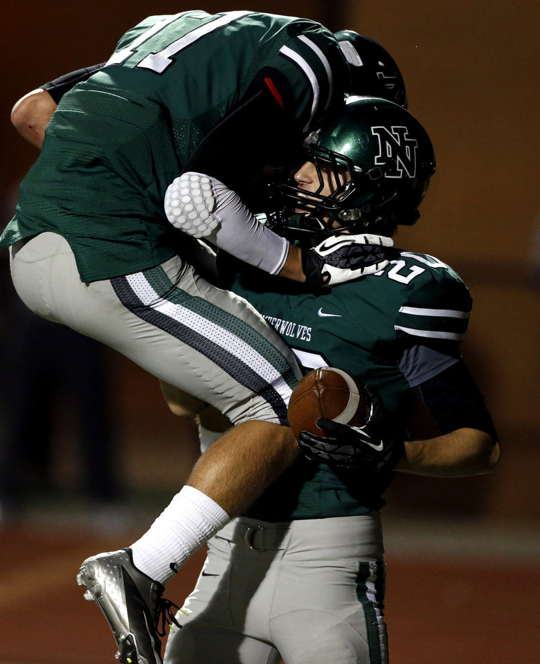 Photo - Norman North Timberwolf Corbin Cleveland gets congratulations from quarterback Channing Meyer after a touchdown pass reception as Broken Arrow plays Norman North in class 6A football on Friday, Nov. 16, 2012 in Norman, Okla.  Photo by Steve Sisney, The Oklahoman