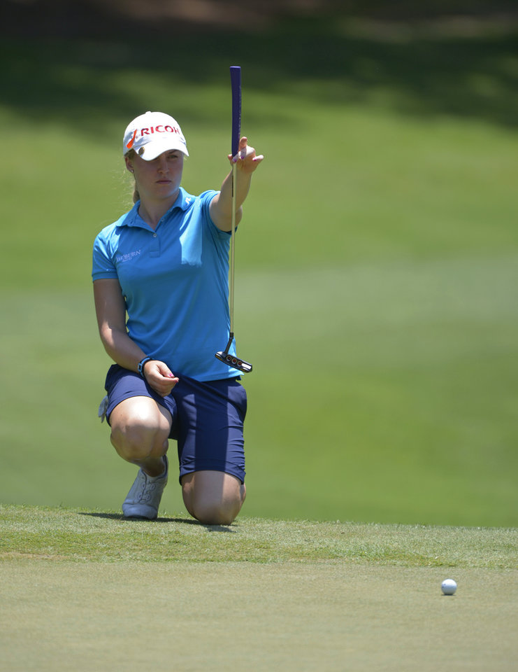 Photo - Charley Hull of England lines up a putt on the ninth green during the second round of the Airbus LPGA Classic golf tournament at Magnolia Grove on Friday, May 23, 2014,  in Mobile, Ala. (AP Photo/G.M. Andrews)