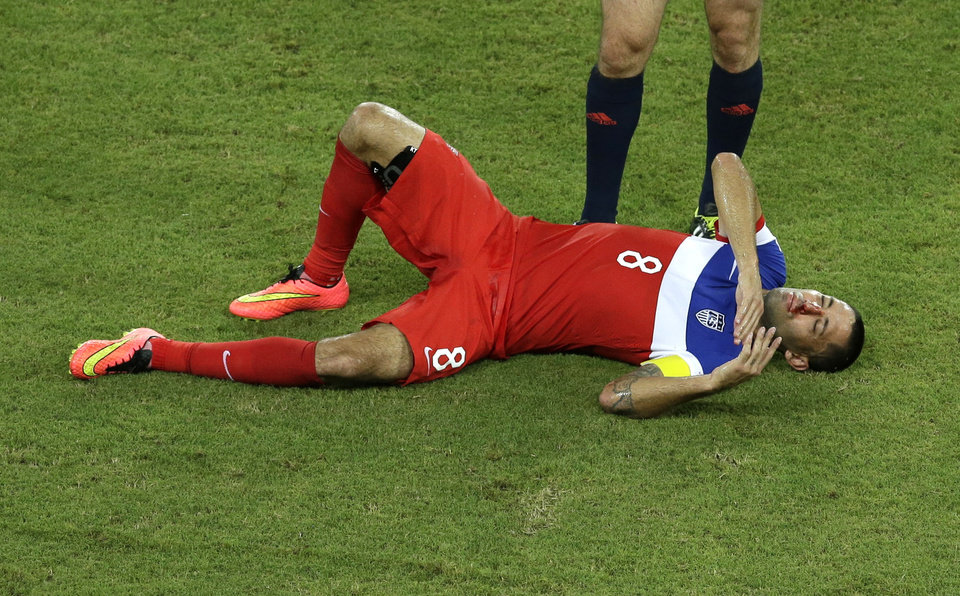 Photo - United States' Clint Dempsey lies on the pitch after being kicked in the face during the group G World Cup soccer match between Ghana and the United States at the Arena das Dunas in Natal, Brazil, Monday, June 16, 2014. (AP Photo/Hassan Ammar)