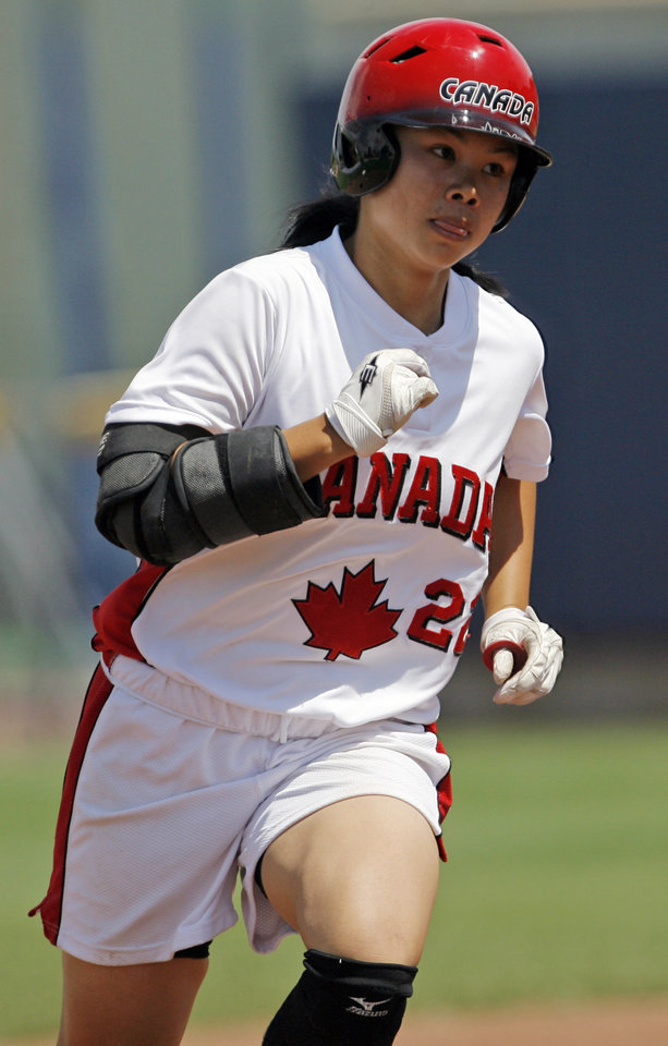 Photo - Canada's Jennifer Yee (22) runs the bases after hitting a home run in the fifth inning during the game between Australia and Canada in the World Cup of Softball at ASA Hall of Fame Stadium in Oklahoma City, Friday, July 17, 2009. By Nate Billings, The Oklahoman ORG XMIT: KOD
