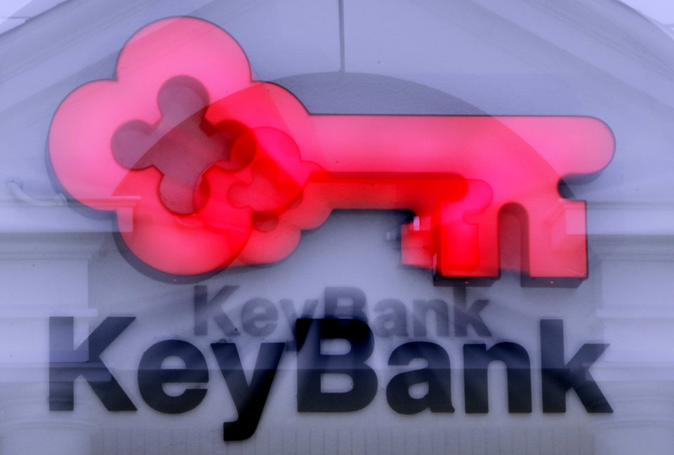 FILE - This Tuesday, Jan. 25, 2011, file photo, shows a sign at a KeyBank branch in Indianapolis. Regional banking company KeyCorp said Thursday Jan. 23, 2013 it\'s fourth quarter earnings climbed 1.5 percent, as revenue growth and a discontinued business gain countered costs from an efficiency initiative. (AP Photo/Michael Conroy, File)