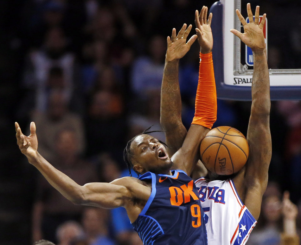 Photo - Oklahoma City's Jerami Grant (9) collides with Philadelphia's Amir Johnson (5) in the third quarter during an NBA basketball game between the Philadelphia 76ers and the Oklahoma City Thunder at Chesapeake Energy Arena in Oklahoma City, Thursday, Feb. 28, 2019. Philadelphia won 108-104. Photo by Nate Billings, The Oklahoman