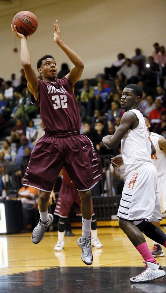 Photo - Deshawn Watson (32) of Northeast shoots against Glenn Banks (13) of Douglass during a boys high school basketball game between Douglass and Northeast at Douglass High School in Oklahoma City, Friday, Feb. 8, 2013. Photo by Nate Billings, The Oklahoman
