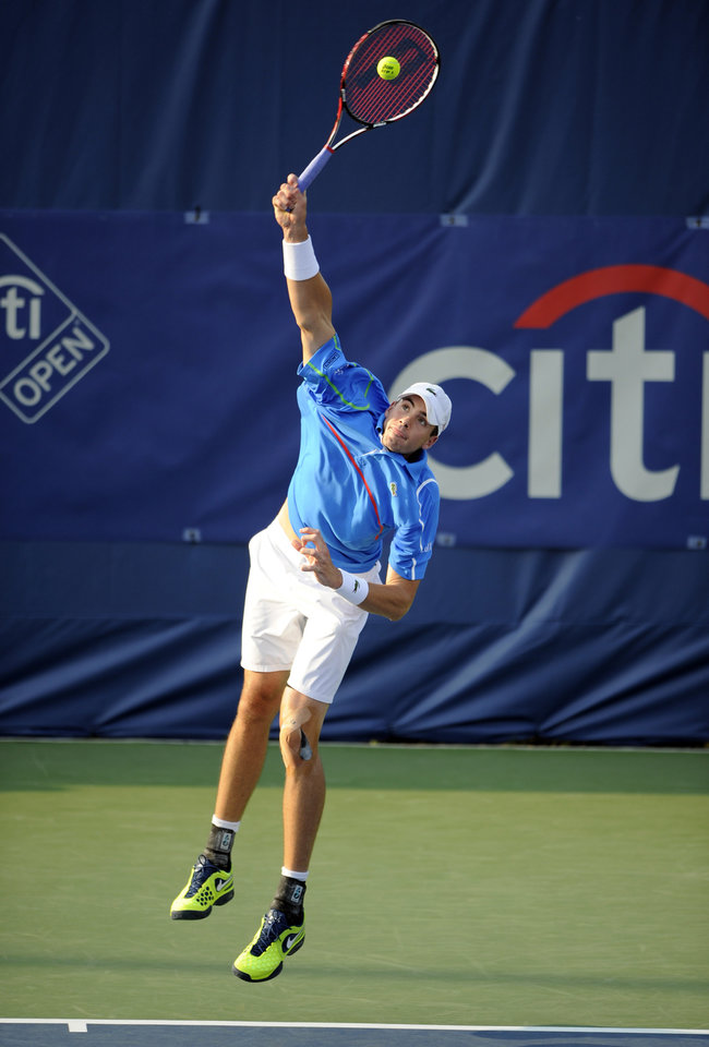 Photo - John Isner serves against Steve Johnson during a match at the Citi Open tennis tournament, Wednesday, July 30, 2014, in Washington. (AP Photo/Nick Wass)