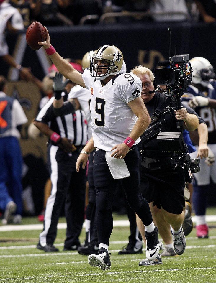 New Orleans Saints quarterback Drew Brees (9) reacts after completing a touchdown pass for his 48th consecutive game, breaking Johnny Unitas' NFL record which stood for over 50 years, during an NFL football game against the San Diego Chargers at the Mercedes-Benz Superdome in New Orleans, Sunday, Oct. 7, 2012. (AP Photo/Bill Haber)