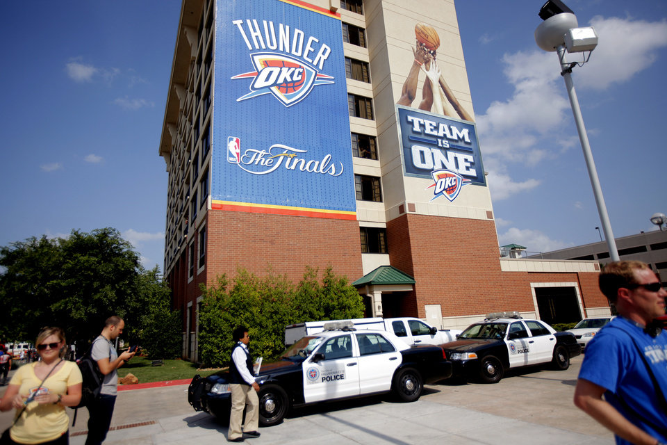 Photo - A line of Oklahoma City police cars are parked outside the arena before Game 2 of the NBA Finals between the Oklahoma City Thunder and the Miami Heat at Chesapeake Energy Arena in Oklahoma City, Thursday, June 14, 2012. Photo by Bryan Terry, The Oklahoman
