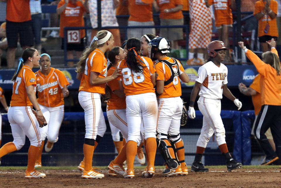 Tennessee celebrates their as Texas' Brejae Washington walks off the field during Women's College World Series softball game at ASA Hall of Fame Stadium in Oklahoma City, Sunday, June, 2, 2013. Photo by Sarah Phipps, The Oklahoman Download