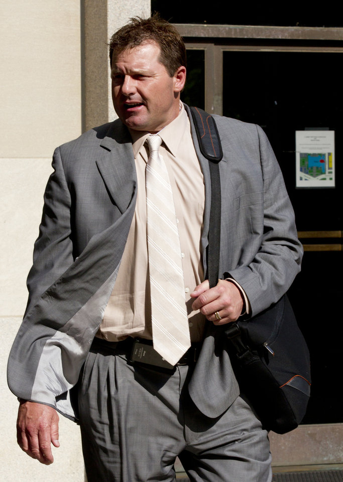 Photo -   Former Major League Baseball pitcher Roger Clemens, who is accused of lying to Congress in 2008 when he denied using performance-enhancing drugs, leaves federal court in Washington, Friday, May 25, 2012. A forensic scientist testified Friday that two cotton balls and a syringe needle allegedly saved after a steroids injection, tested positive for Roger Clemens' DNA, a key moment as the government tries to prove the former pitcher used performance-enhancing drugs. (AP Photo/Manuel Balce Ceneta)