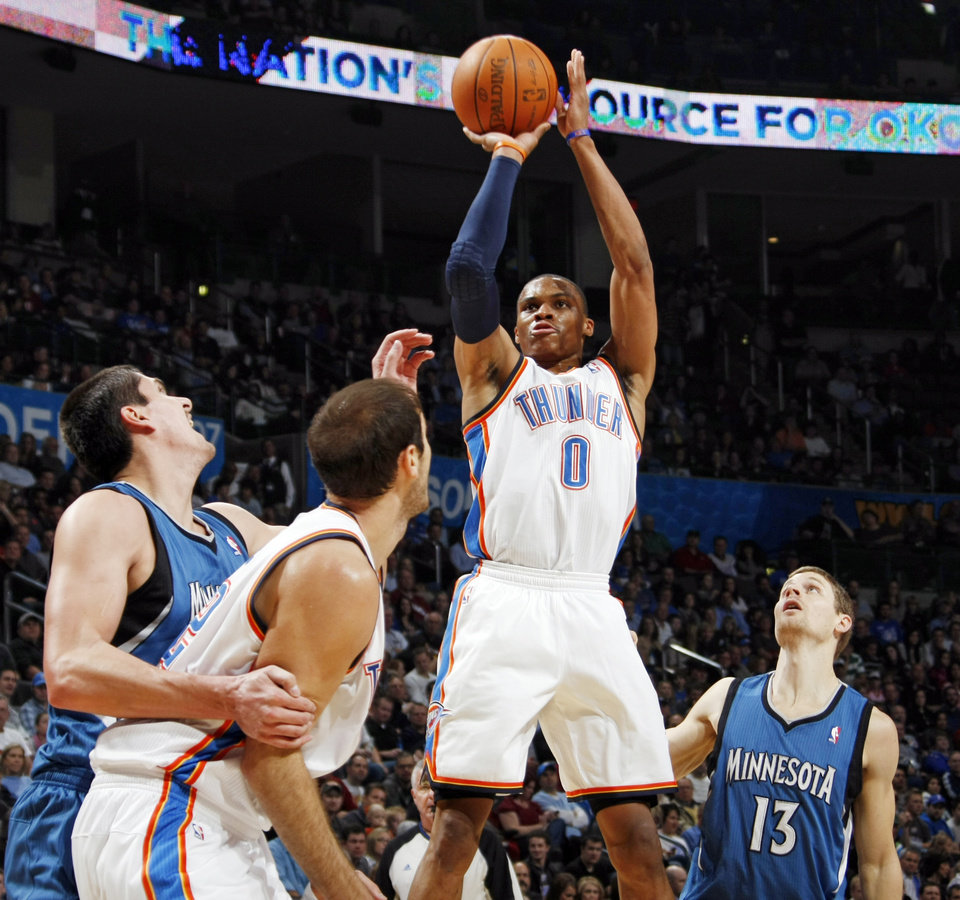 Photo - Oklahoma City's Russell Westbrook (0) takes a shot in front of Luke Ridnour (13) of Minnesota as Oklahoma City's Nenad Krstic (12) blocks Darko Milicic (31) of Minnesota during the NBA basketball game between the Minnesota Timberwolves and the Oklahoma City Thunder at the Oklahoma City Arena, Monday, November 22, 2010, in Oklahoma City. Photo by Nate Billings, The Oklahoman