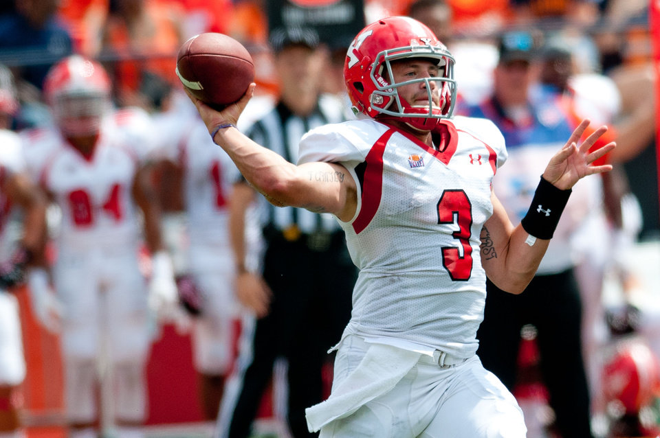 Photo - Youngstown State quarterback Dante Nania (3) passes during the first quarter of an NCAA college football game against Illinois, Saturday, Aug. 30, 2014, at Memorial Stadium in Champaign, Ill. (AP Photo/Bradley Leeb)