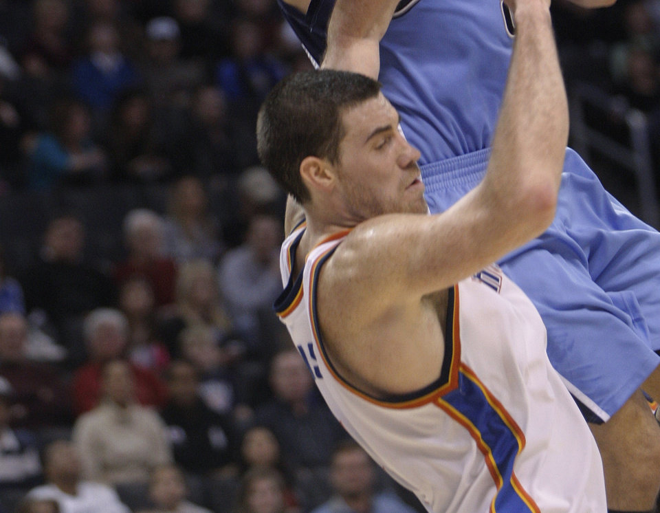 OKC�s Nick Collison, bottom, isn�t afraid of putting his body infront of an opponent, like he did here against Utah�s Deron Williams. AP photo