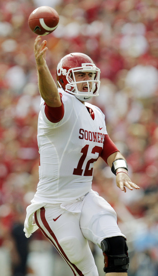 Photo - OU quarterback Landry Jones (12) passes in the first half during the Red River Rivalry college football game between the University of Oklahoma Sooners (OU) and the University of Texas Longhorns (UT) at the Cotton Bowl in Dallas, Friday, Oct. 7, 2011. Photo by Nate Billings, The Oklahoman