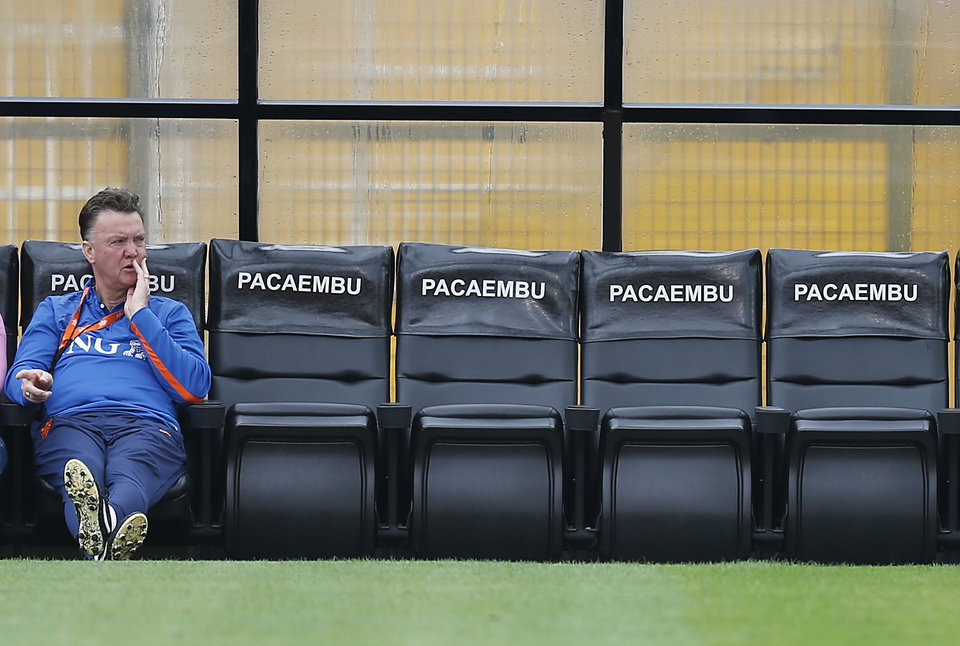 Photo - Netherlands' head coach Louis van Gaal watches his team during a training session of The Netherlands in Sao Paulo, Brazil, Thursday, July 10, 2014. The Netherlands will face Brazil for the match for third place at the 2014 soccer World Cup. (AP Photo/Frank Augstein)