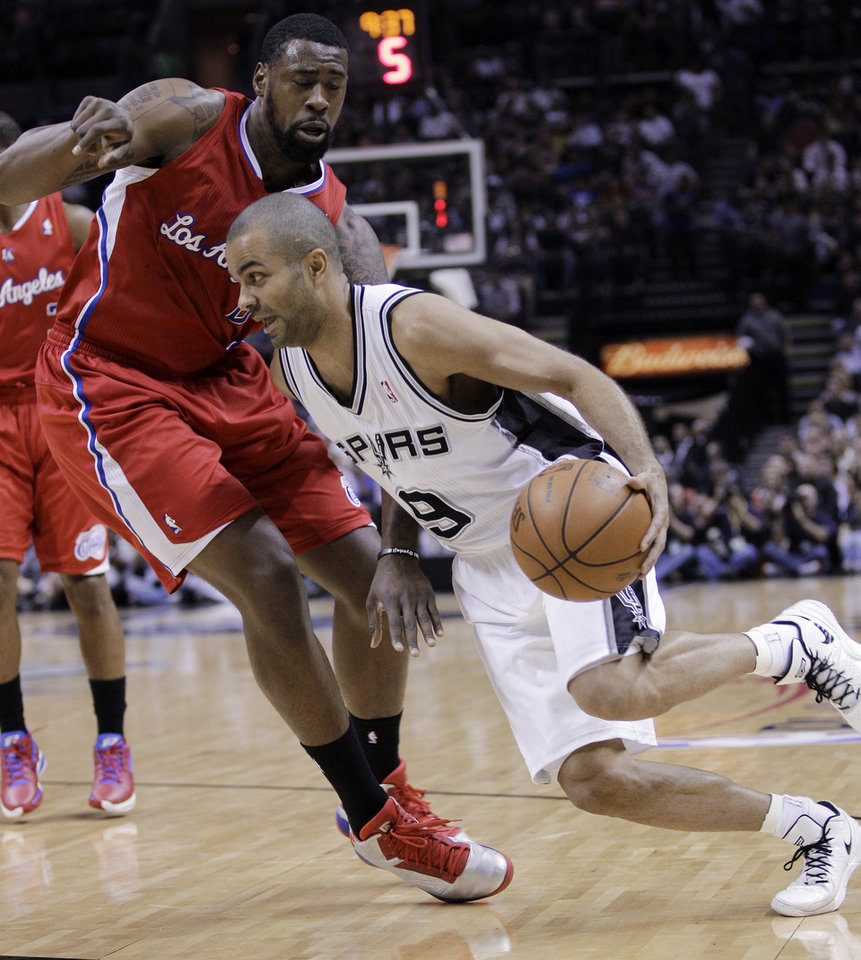 Photo -   San Antonio Spurs' Tony Parker, right, of France, drives past Los Angeles Clippers' DeAndre Jordan, left, during the first quarter of Game 2 of an NBA basketball Western Conference semifinal playoff series, Thursday, May 17, 2012, in San Antonio. (AP Photo/Eric Gay)