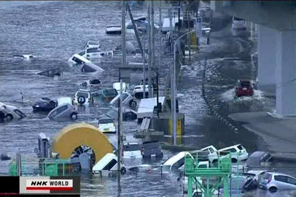 Photo - In this video image taken from Japan's NHK TV, cars are washed away in a coastal area of Kamaishi, Iwate prefecture Japan Friday March 11, 2011 following a massive earth quake. A magnitude 8.9 earthquake slammed Japan's northeastern coast Friday, unleashing a 13-foot (4-meter) tsunami that swept boats, cars, buildings and tons of debris miles inland. Fires triggered by the quake burned out of control up and down the coast.  (AP PHOTO/NHK TV) MANDATORY CREDIT, JAPAN OUT, TV OUT,  NO SALES, EDITORIAL USE ONLY ORG XMIT: LON816