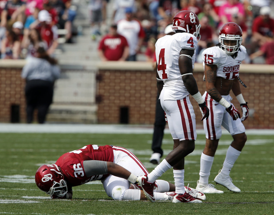 Photo - Dimitri Flowers (36) is injured during the Spring College Football Game of the University of Oklahoma Sooners (OU) at Gaylord Family-Oklahoma Memorial Stadium in Norman, Okla., on Saturday, April 12, 2014.  Photo by Steve Sisney, The Oklahoman
