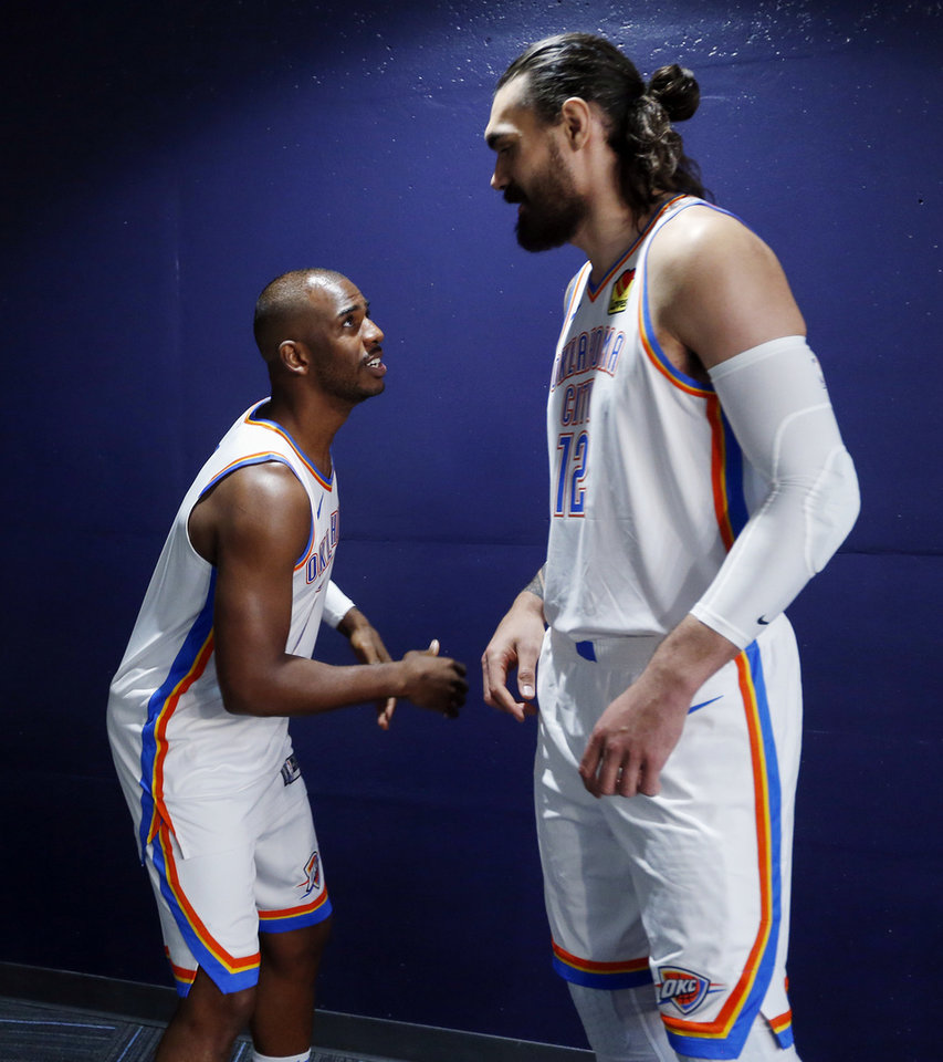Photo - Oklahoma City's Chris Paul, left, and Steven Adams talk after Paul finished his press conference and Adams was about to speak to the media during media day for the Oklahoma City Thunder NBA basketball team at Chesapeake Energy Arena in Oklahoma City, Monday, Sept. 30, 2019. [Nate Billings/The Oklahoman]