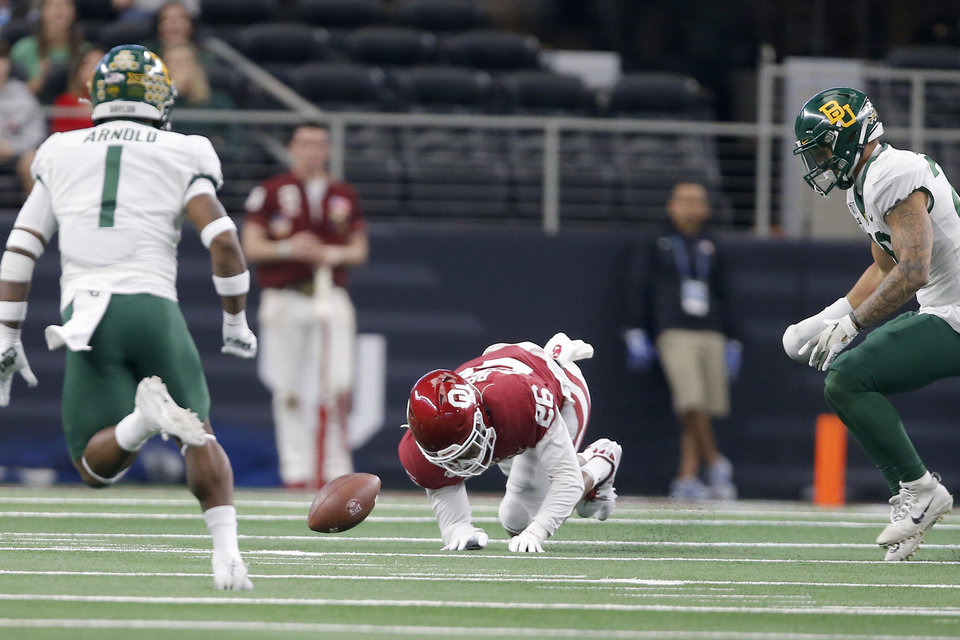 Photo - Oklahoma's Kennedy Brooks (26) is unable to recover a fumble by Oklahoma during the Big 12 Championship Game between the University of Oklahoma Sooners (OU) and the Baylor University Bears at AT&T Stadium in Arlington, Texas, Saturday, Dec. 7, 2019. [Bryan Terry/The Oklahoman]