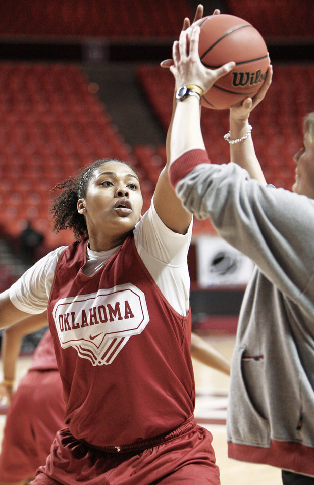 Photo - Oklahoma center Abi Olajuwon blocks a shot during practice  Saturday in Norman. AP PHOTO