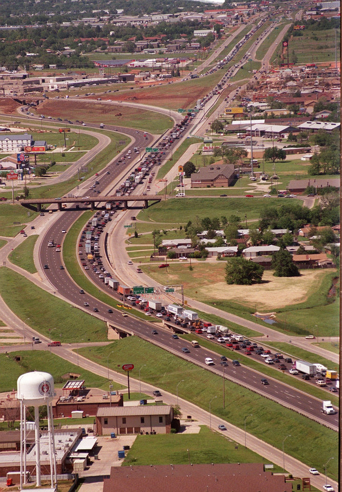 Aerial view, Tornado aftermath: Interstate 35 in Moore looking North from the 5th St. overpass at traffic backed up from both directions.