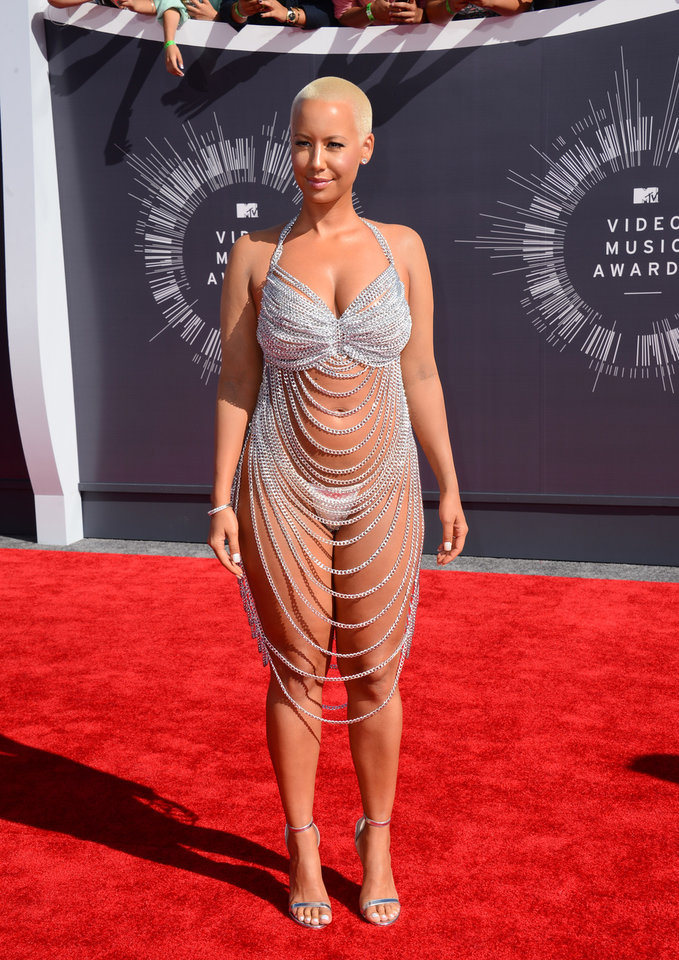 Photo - Amber Rose arrives at the MTV Video Music Awards at The Forum on Sunday, Aug. 24, 2014, in Inglewood, Calif. (Photo by Jordan Strauss/Invision/AP)