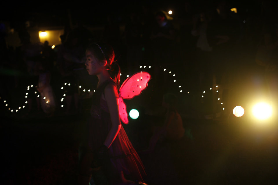 A fairy makes her way to the dance floor during the StarDanceSwan��s Fairy Ball on Paseo in Oklahoma City, Saturday, Sept. 21, 2013. Photo by Sarah Phipps, The Oklahoman