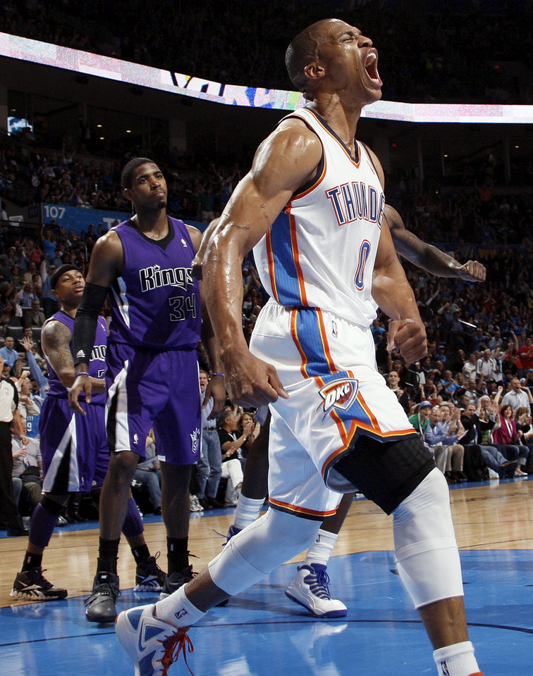 Oklahoma City\'s Russell Westbrook (0) reacts in front of Sacramento\'s Isaiah Thomas (22) and Jason Thompson (34) after dunking the ball on a lob pass from Kevin Durant during the NBA basketball game between the Oklahoma City Thunder and the Sacramento Kings at Chesapeake Energy Arena in Oklahoma City, Friday, April 13, 2012. Photo by Nate Billings, The Oklahoman
