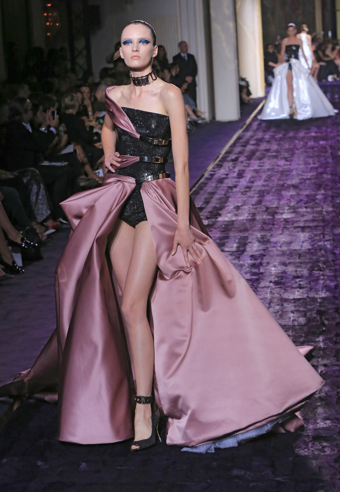 Photo - A model presents a creation by Italian fashion designer Donatella Versace, as part of the Atelier Versace Fall Winter 2014-15 Haute Couture fashion collection, Sunday, July 6, in Paris. (AP Photo/Jacques Brinon)