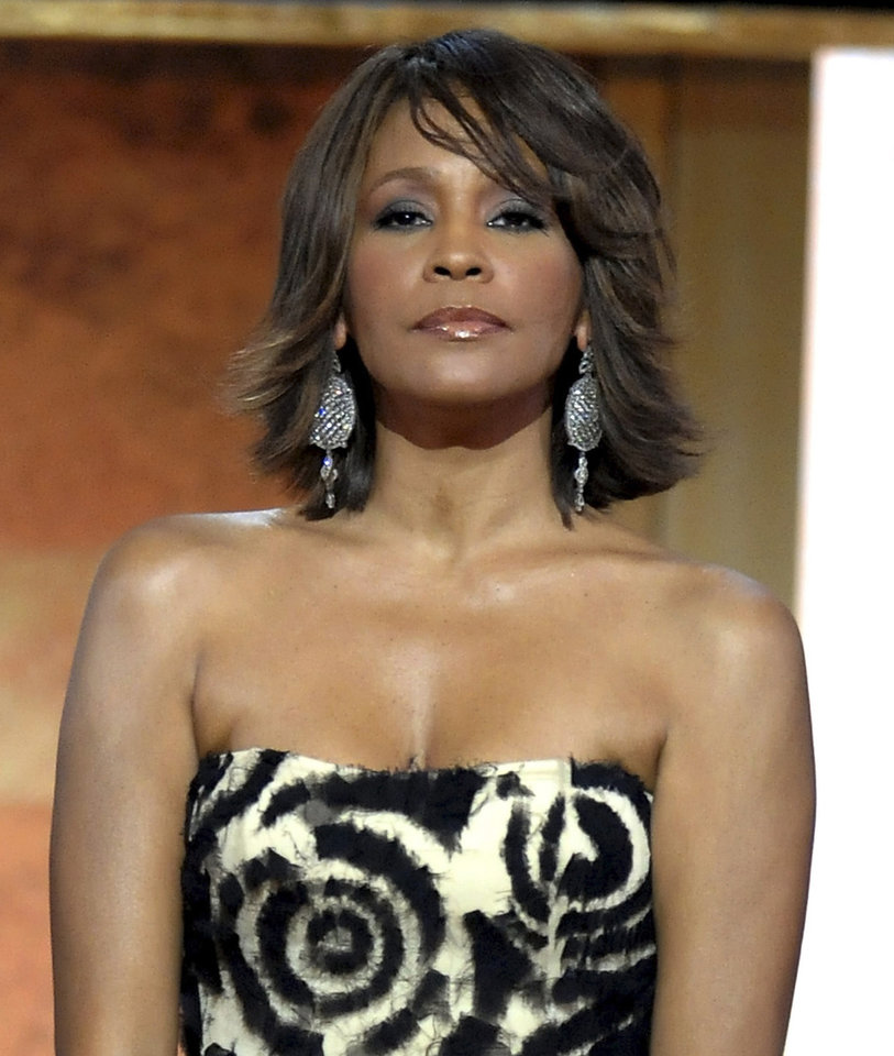 FILE - This Jan. 17, 2009 file photo shows singer Whitney Houston at the BET Honors in the Warner Theatre in Washington.  Houston died Saturday, Feb. 11, 2012, she was 48.  (AP Photo/Evan Agostini, File) ORG XMIT: NY122