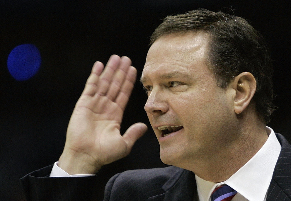 Photo - NCAA TOURNAMENT: University of Kansas head coach Bill Self gestures on the sidelines during the championship game against Memphis at the NCAA college basketball Final Four Monday, April 7, 2008, in San Antonio. (AP Photo/Eric Gay) ORG XMIT: FF152
