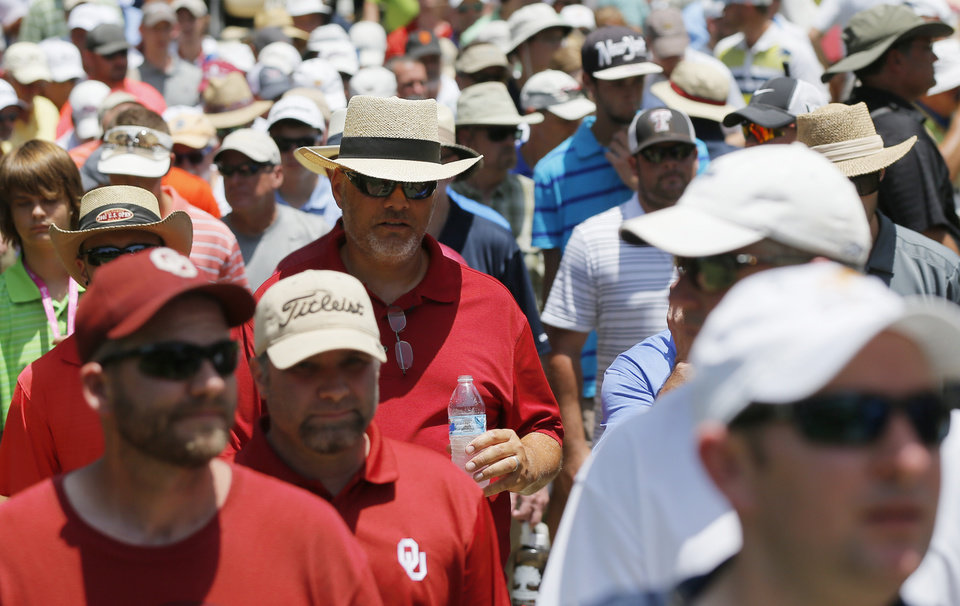 Photo - Spectators walk between No. 4 and No. 5 during the final round of the U.S. Senior Open golf tournament at Oak Tree National in Edmond, Okla., Sunday, July 13, 2014. Photo by Nate Billings, The Oklahoman