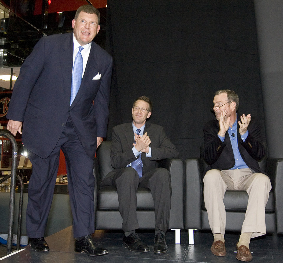 Photo - Team chairman Clay Bennett takes the stage in front of general manager Sam Presti, middle, and head coach PJ Carlesimo during the unveiling of the Oklahoma City Thunder NBA team name at Leadership Square in downtown Oklahoma City, Wednesday, September 3, 2008. NATE BILLINGS, THE OKLAHOMAN