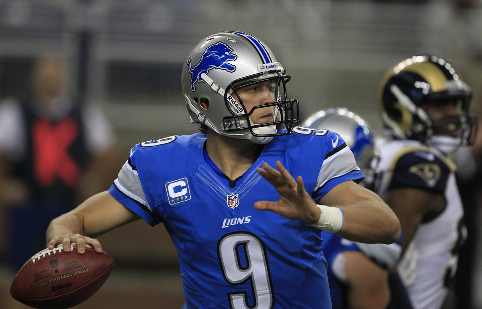Photo -   Detroit Lions quarterback Matthew Stafford (9) looks downfield during the first quarter of an NFL football game against the St. Louis Rams in Detroit, Sunday, Sept. 9, 2012. (AP Photo/Carlos Osorio)