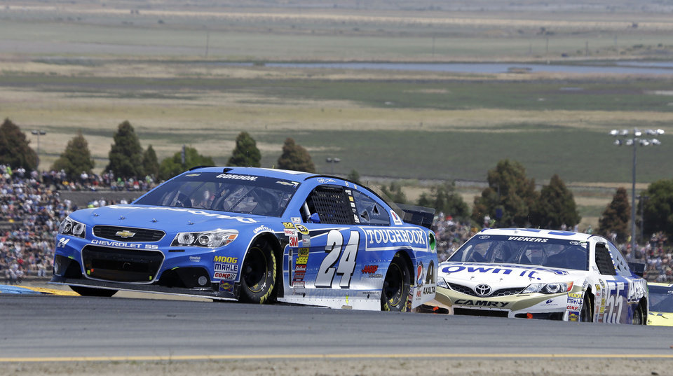 Photo - Jeff Gordon leads Brian Vickers during the NASCAR Sprint Cup Series auto race Sunday, June 22, 2014, in Sonoma, Calif. (AP Photo/Eric Risberg)