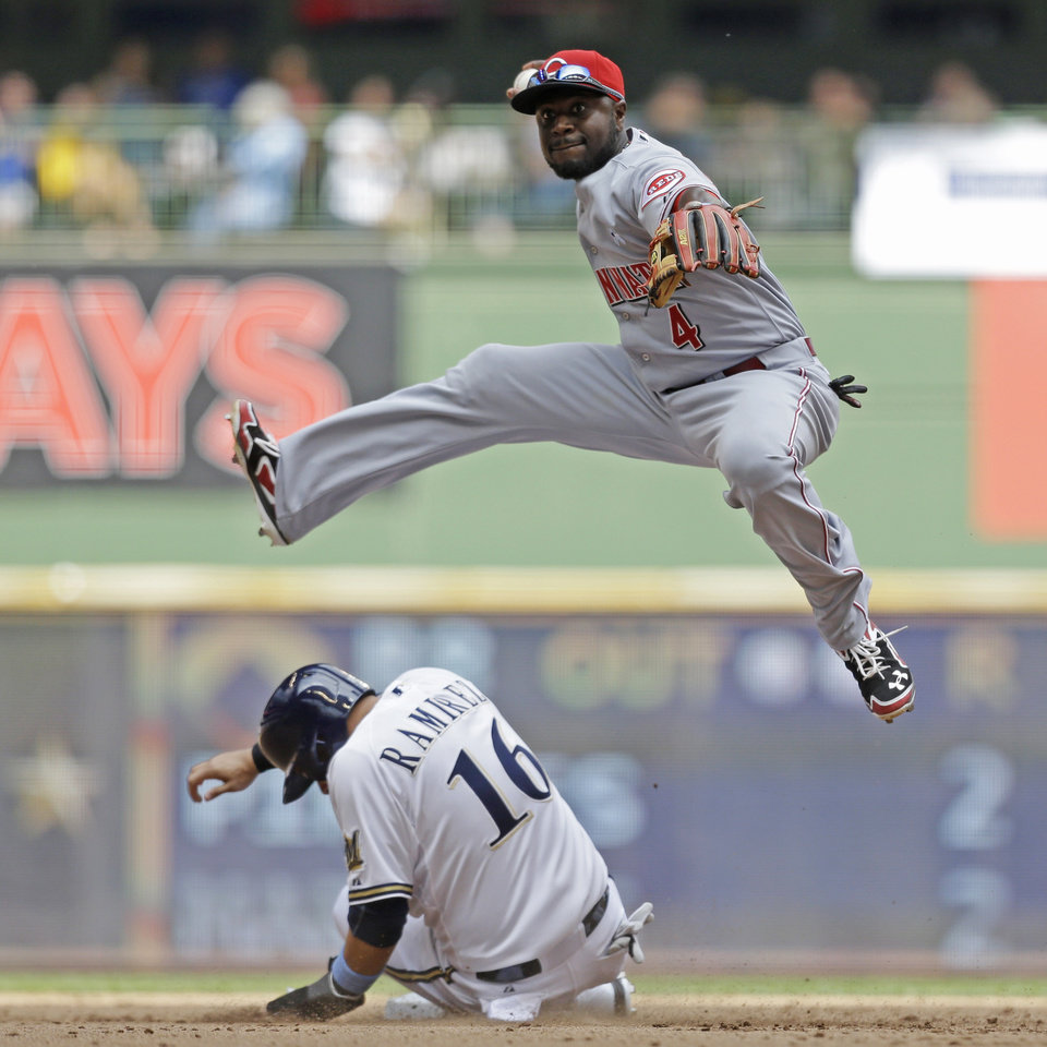 Photo - Cincinnati Reds' Brandon Phillips forces out Milwaukee Brewers' Aramis Ramirez at second base during the fifth inning of a baseball game, Sunday, June 15, 2014, in Milwaukee. (AP Photo/Jeffrey Phelps)
