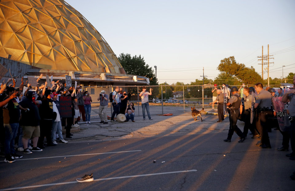 Photo - Oklahoma City police attempt to stop a crowd of protesters near the intersection of 23rd and Classen in Oklahoma City, Saturday, May 30, 2020. The protest was in response to the death of George Floyd. [Bryan Terry/The Oklahoman]