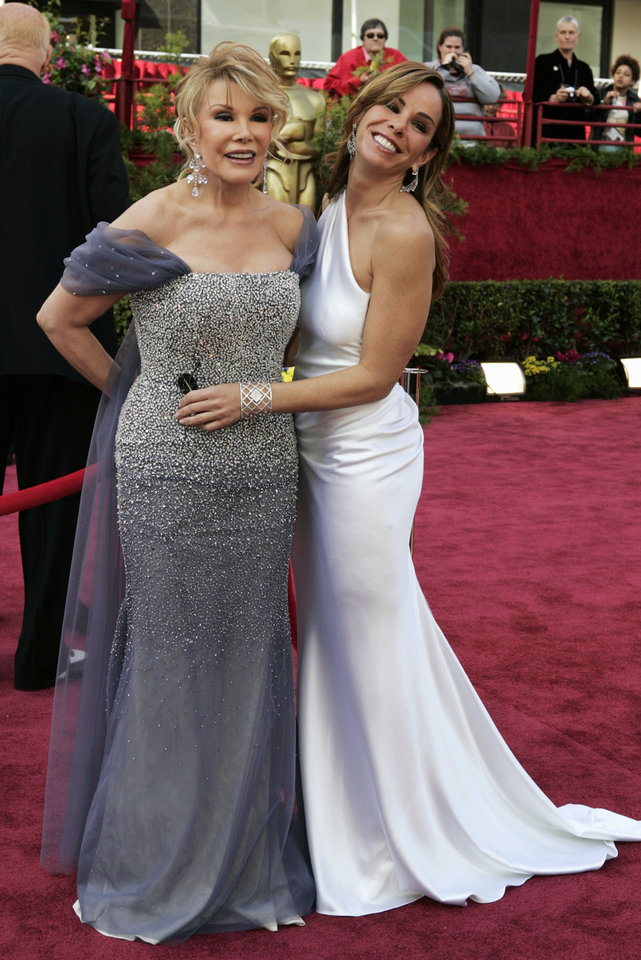 Photo - FILE - This Feb. 27, 2005 file photo shows Joan Rivers, left, and her daughter, Melissa, from the TV Guide Channel on the red carpet for Oscar arrivals before the 77th annual Academy Awards in Los Angeles. Rivers, the raucous, acid-tongued comedian who crashed the male-dominated realm of late-night talk shows and turned Hollywood red carpets into danger zones for badly dressed celebrities,  died Thursday, Sept. 4, 2014. She was 81. Rivers was hospitalized Aug. 28, after going into cardiac arrest at a doctor's office.  (AP Photo/Amy Sancetta, File)
