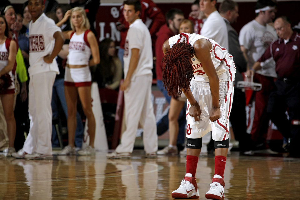 Photo - OU's Danielle Robinson (13) reacts after OU's loos in the Big 12 women's basketball game between the University of Oklahoma and Texas A&M at Lloyd Noble Center in Norman, Okla., Wednesday January 26, 2011.  Photo by Bryan Terry, The Oklahoman