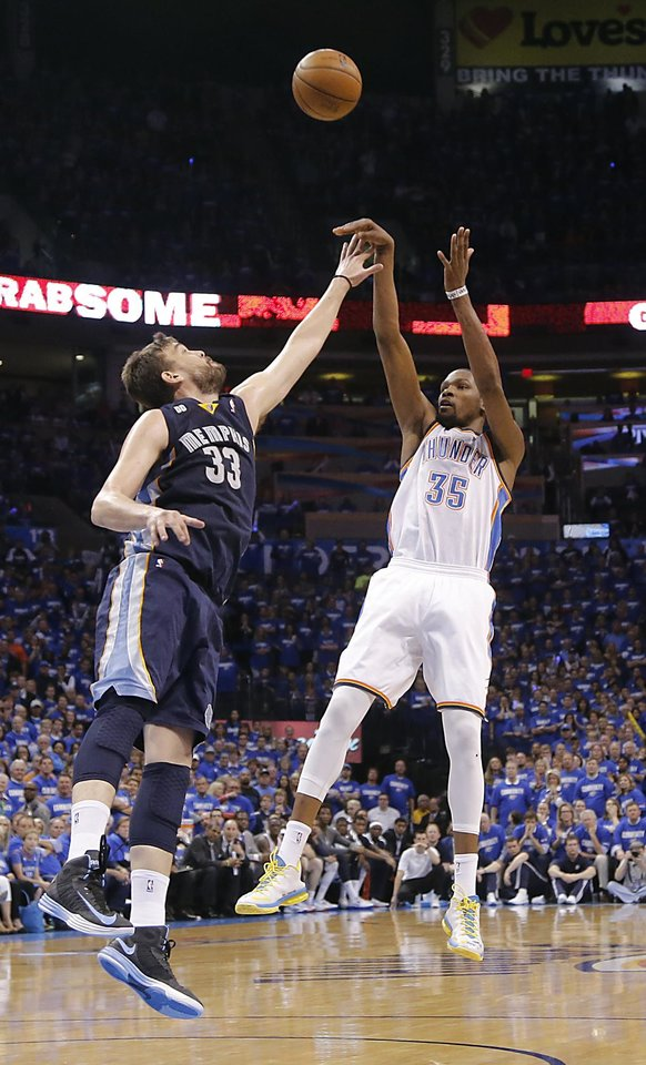 Oklahoma City's Kevin Durant (35) shoots over Memphis' Marc Gasol (33) during the second round NBA playoff basketball game between the Oklahoma City Thunder and the Memphis Grizzlies at Chesapeake Energy Arena in Oklahoma City, Sunday, May 5, 2013. Photo by Chris Landsberger, The Oklahoman