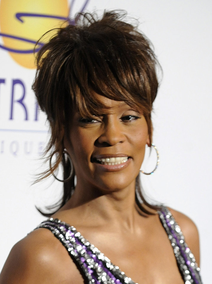 FILE  - In this Feb. 9, 2008 file photo, singer Whitney Houston arrives at the Clive Davis Pre-Grammy Party in Beverly Hills, Calif. Whitney Houston, who reigned as pop music's queen until her majestic voice and regal image were ravaged by drug use, has died, Saturday, Feb. 11, 2012. She was 48. (AP Photo/Chris Pizzello, file) ORG XMIT: NY129