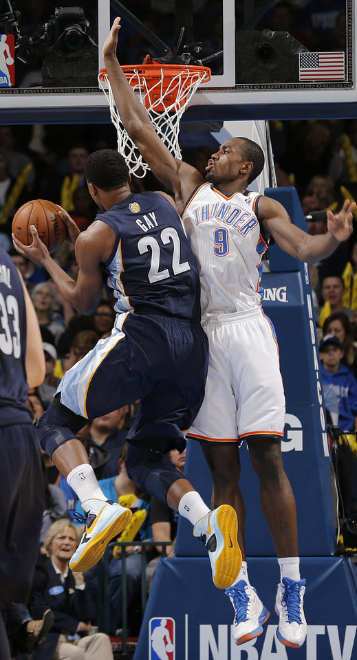 Photo - Oklahoma City's Serge Ibaka (9) defends on Memphis' Rudy Gay (22) during the NBA basketball game between the Oklahoma City Thunder and the Memphis Grizzlies at Chesapeake Energy Arena on Wednesday, Nov. 14, 2012, in Oklahoma City, Okla.   Photo by Chris Landsberger, The Oklahoman