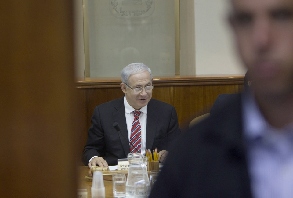 Photo -   Israel's Prime Minister Benjamin Netanyahu attends the weekly cabinet meeting in Jerusalem Sunday, April 29, 2012. (AP Photo/Ronen Zvulun, Pool)