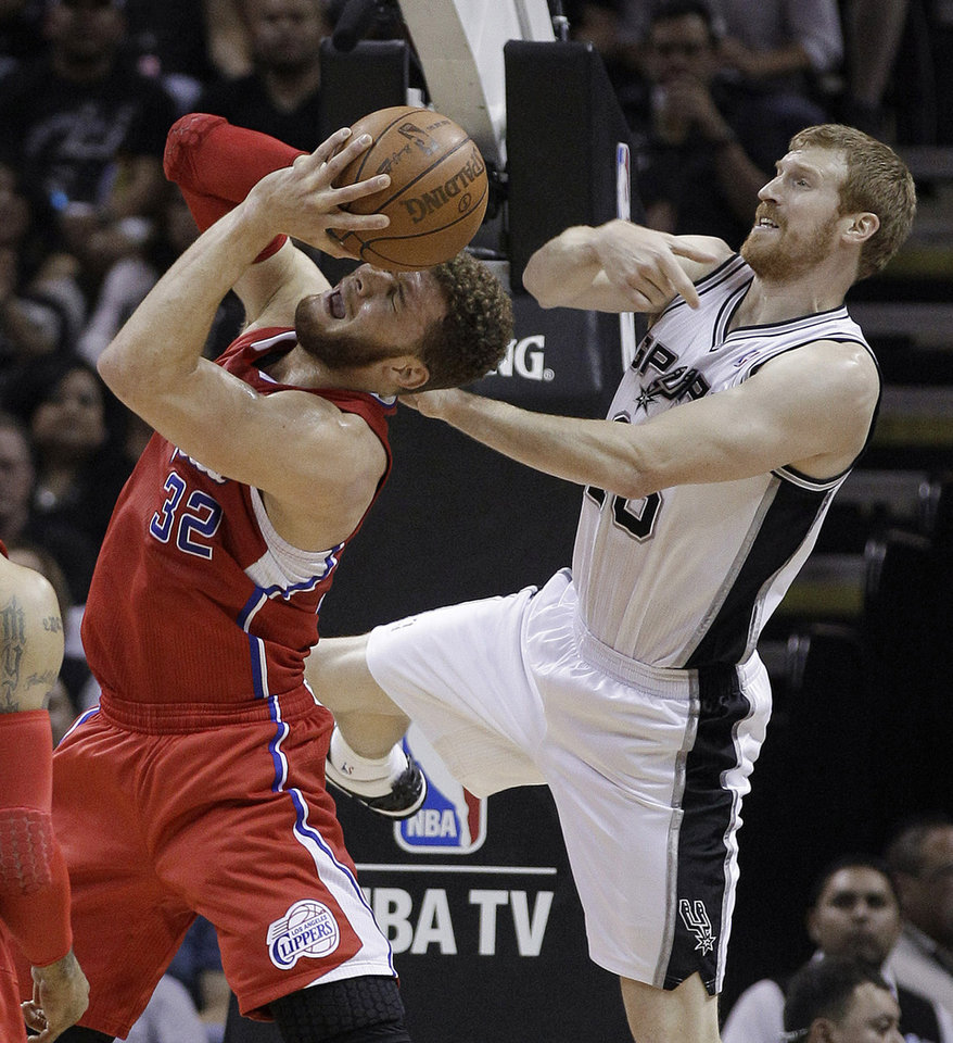 Photo -   Los Angeles Clippers' Blake Griffin (32) has his shot stopped by San Antonio Spurs' Matt Bonner, right, during the first quarter of Game 2 of an NBA basketball Western Conference semifinal playoff series, Thursday, May 17, 2012, in San Antonio. (AP Photo/Eric Gay)